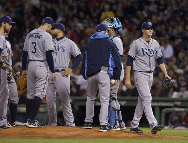 May 31, 2014; Boston, MA, USA; Tampa Bay Rays starting pitcher Jake Odorizzi (23) (right) is relived in the fourth inning against the Boston Red Sox at Fenway Park. Mandatory Credit: David Butler II-USA TODAY Sports