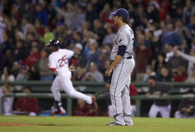 May 31, 2014; Boston, MA, USA; Tampa Bay Rays relief pitcher Cesar Ramos (27) looks on after a two run home run by Boston Red Sox center fielder Jackie Bradley Jr. (25) in the fifth inning at Fenway Park. Mandatory Credit: David Butler II-USA TODAY Sports