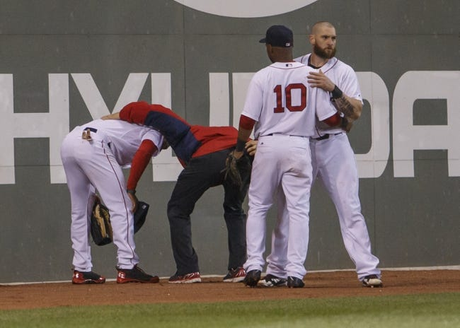 May 31, 2014; Boston, MA, USA; Boston Red Sox left fielder Jonny Gomes (5) and third baseman Jonathan Herrera (10) show concern for their teammate center fielder Jackie Bradley Jr. (25) after hitting the wall on a play as they take on the Tampa Bay Rays in the eighth inning at Fenway Park. Mandatory Credit: David Butler II-USA TODAY Sports