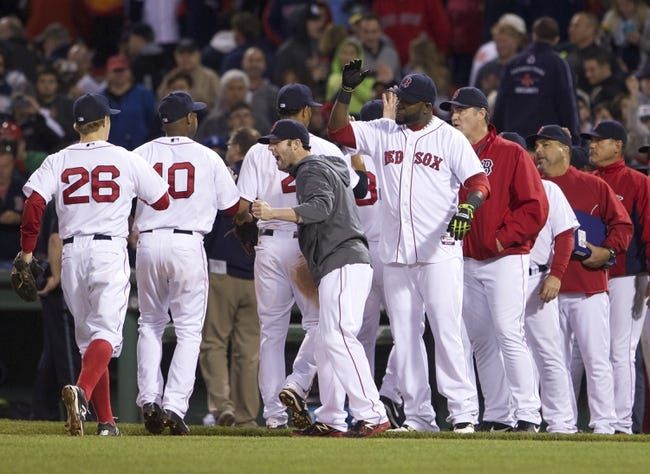 May 31, 2014; Boston, MA, USA; Boston Red Sox second baseman Dustin Pedroia (15), designated hitter David Ortiz (34) celebrates with teammates after defeating the Tampa Bay Rays 7-1 in the ninth inning at Fenway Park. Mandatory Credit: David Butler II-USA TODAY Sports