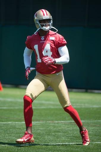 May 28, 2014; Santa Clara, CA, USA; San Francisco 49ers wide receiver Kassim Osgood (14) during organized team activities at the SAP Performance Facility. Mandatory Credit: Kyle Terada-USA TODAY Sports