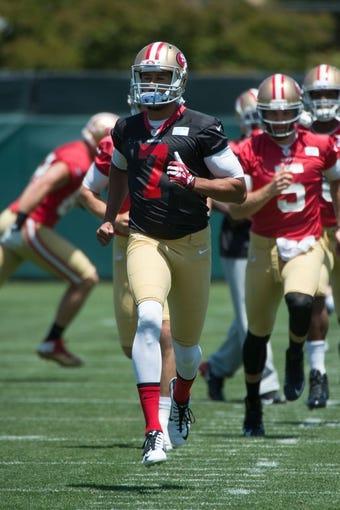 May 28, 2014; Santa Clara, CA, USA; San Francisco 49ers quarterback Colin Kaepernick (7) during organized team activities at the SAP Performance Facility. Mandatory Credit: Kyle Terada-USA TODAY Sports