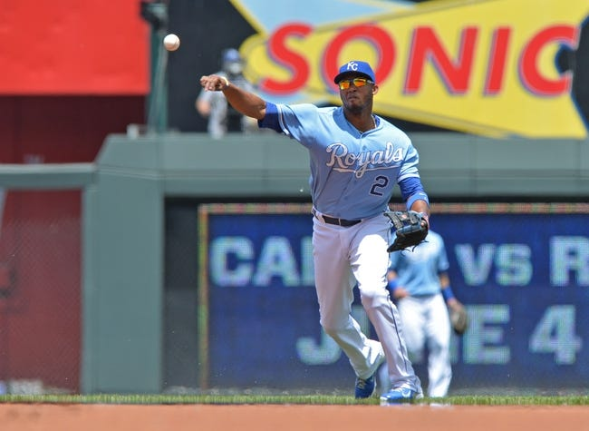 May 28, 2014; Kansas City, MO, USA; Kansas City Royals shortstop Alcides Escobar (2) makes a throw to first against the Houston Astros during the first inning at Kauffman Stadium. Mandatory Credit: Peter G. Aiken-USA TODAY Sports