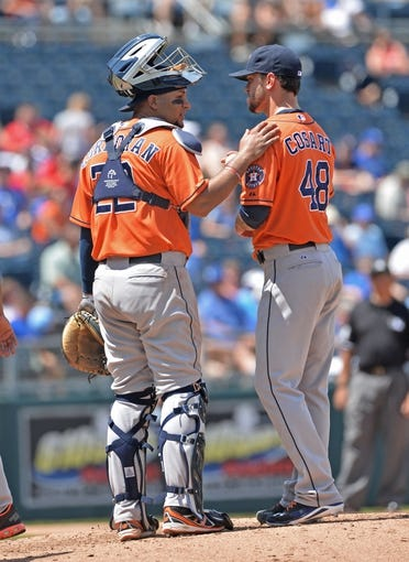 May 28, 2014; Kansas City, MO, USA; Houston Astros pitcher Jarred Cosart (48) talks with catcher Carlos Corporan (22) during the fourth inning against the Kansas City Royals at Kauffman Stadium. Mandatory Credit: Peter G. Aiken-USA TODAY Sports