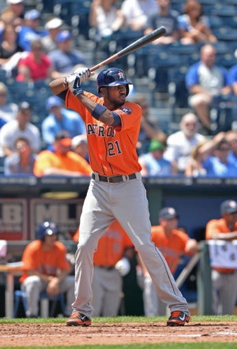 May 28, 2014; Kansas City, MO, USA; Houston Astros center fielder Dexter Fowler (21) at bat against the Kansas City Royals during the fifth inning at Kauffman Stadium. Mandatory Credit: Peter G. Aiken-USA TODAY Sports