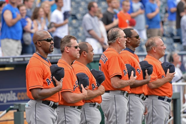 May 28, 2014; Kansas City, MO, USA; Houston Astros manager Bo Porter (far left) stands with his coaching staff before a game against the Kansas City Royals at Kauffman Stadium. Mandatory Credit: Peter G. Aiken-USA TODAY Sports