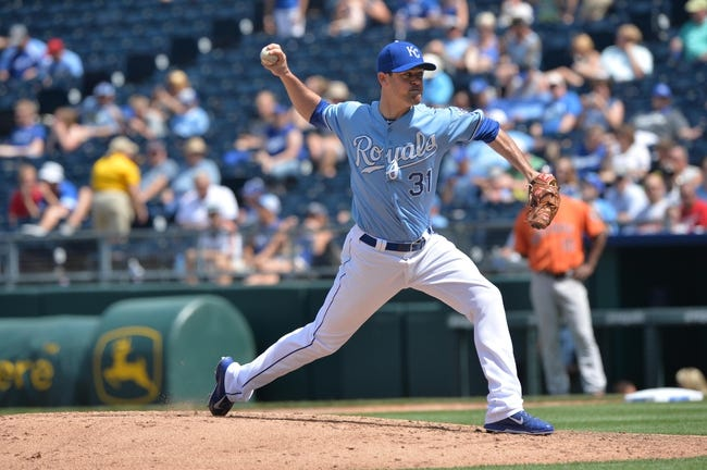 May 28, 2014; Kansas City, MO, USA; Kansas City Royals pitcher Louis Coleman (31) delivers a pitch against the Houston Astros during the seventh inning at Kauffman Stadium. Mandatory Credit: Peter G. Aiken-USA TODAY Sports