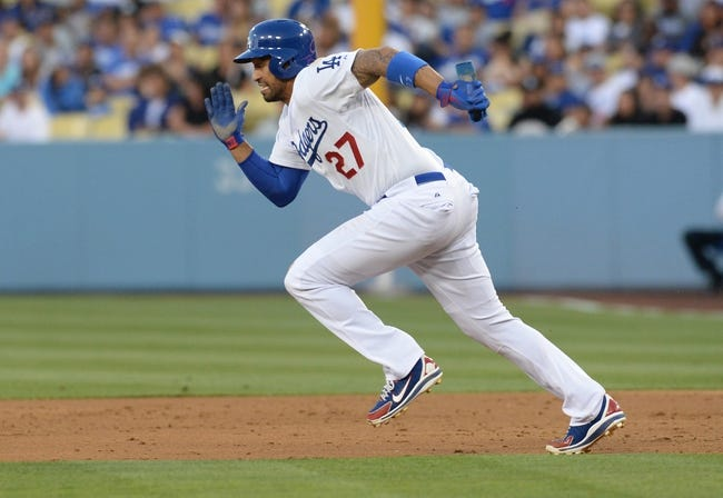 Jun 3, 2014; Los Angeles, CA, USA; Los Angeles Dodgers center fielder Matt Kemp (27) runs to second base in the second inning of the game against the Chicago White Sox at Dodger Stadium. Mandatory Credit: Jayne Kamin-Oncea-USA TODAY Sports