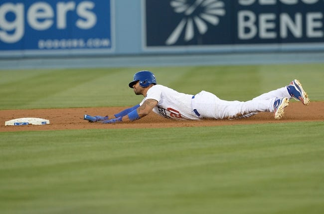 Jun 3, 2014; Los Angeles, CA, USA; Los Angeles Dodgers center fielder Matt Kemp (27) is safe at second base in the second inning of the game against the Chicago White Sox at Dodger Stadium. Mandatory Credit: Jayne Kamin-Oncea-USA TODAY Sports