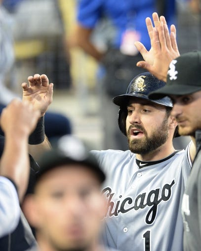 Jun 3, 2014; Los Angeles, CA, USA; Chicago White Sox center fielder Adam Eaton (1) is greeted in the dugout after a home run in the third inning of the game against the Los Angeles Dodgers at Dodger Stadium. Mandatory Credit: Jayne Kamin-Oncea-USA TODAY Sports