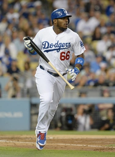 Jun 3, 2014; Los Angeles, CA, USA; Los Angeles Dodgers right fielder Yasiel Puig (66) at bat in the fourth inning of the game against the Chicago White Sox at Dodger Stadium. Mandatory Credit: Jayne Kamin-Oncea-USA TODAY Sports