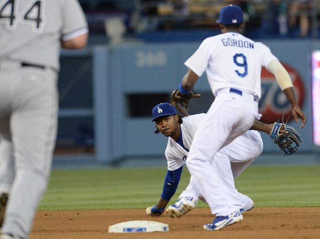 Jun 3, 2014; Los Angeles, CA, USA; Los Angeles Dodgers shortstop Hanley Ramirez (13) throws the ball to second baseman Dee Gordon (9) to get Chicago White Sox designated hitter Adam Dunn (44) out at second base in the fourth inning of the game against the Los Angeles Dodgers at Dodger Stadium. Mandatory Credit: Jayne Kamin-Oncea-USA TODAY Sports