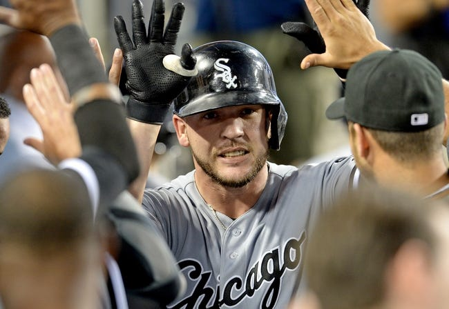 Jun 3, 2014; Los Angeles, CA, USA; Chicago White Sox catcher Tyler Flowers (21) is greeted in the dugout after a home run in the fourth inning of the game against the Los Angeles Dodgers at Dodger Stadium. Mandatory Credit: Jayne Kamin-Oncea-USA TODAY Sports
