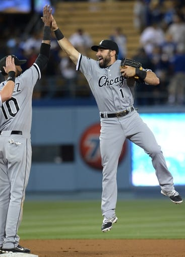 Jun 3, 2014; Los Angeles, CA, USA; Chicago White Sox center fielder Adam Eaton (1) gets a high five from shortstop Alexei Ramirez (10) at the end the game against the Los Angeles Dodgers at Dodger Stadium. White Sox won 4-1. Mandatory Credit: Jayne Kamin-Oncea-USA TODAY Sports