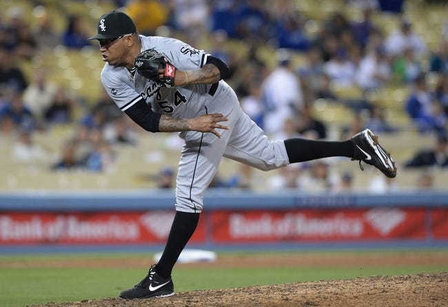 Jun 3, 2014; Los Angeles, CA, USA; Chicago White Sox relief pitcher Ronald Belisario (54) gets a save in the ninth inning of the game against the Los Angeles Dodgers at Dodger Stadium. White Sox won 4-1. Mandatory Credit: Jayne Kamin-Oncea-USA TODAY Sports