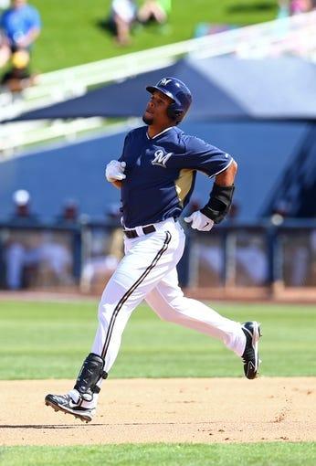 Mar 18, 2014; Phoenix, AZ, USA; Milwaukee Brewers outfielder Carlos Gomez against the Texas Rangers at Maryvale Baseball Park. Mandatory Credit: Mark J. Rebilas-USA TODAY Sports