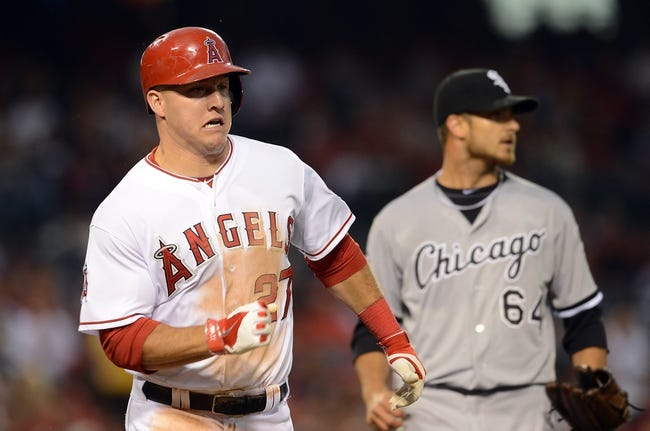 Jun 6, 2014; Anaheim, CA, USA; Los Angeles Angels center fielder Mike Trout (27) runs to first base in the third inning game against the Chicago White Sox at Angel Stadium of Anaheim. Mandatory Credit: Jayne Kamin-Oncea-USA TODAY Sports