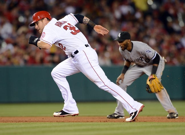 Jun 6, 2014; Anaheim, CA, USA; Los Angeles Angels left fielder Josh Hamilton (32) runs to third base in the fifth inning of the game against the Chicago White Sox at Angel Stadium of Anaheim. Mandatory Credit: Jayne Kamin-Oncea-USA TODAY Sports