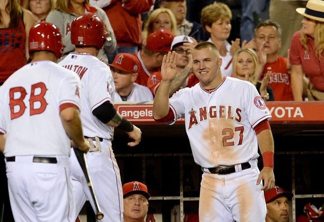 Jun 6, 2014; Anaheim, CA, USA; Los Angeles Angels left fielder Josh Hamilton (32) is greeted at the dugout by  center fielder Mike Trout (27) after he scored a run in the fifth inning of the game against the Chicago White Sox at Angel Stadium of Anaheim. Mandatory Credit: Jayne Kamin-Oncea-USA TODAY Sports