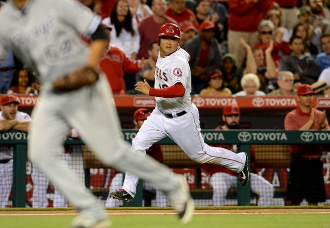 Jun 6, 2014; Anaheim, CA, USA; Los Angeles Angels catcher Hank Conger (16) scores a run in the fifth inning of the game against the Chicago White Sox at Angel Stadium of Anaheim. Mandatory Credit: Jayne Kamin-Oncea-USA TODAY Sports