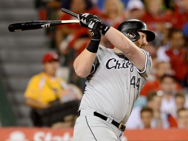 Jun 6, 2014; Anaheim, CA, USA; Chicago White Sox designated hitter Adam Dunn (44) singles in the fifth inning of the game against the Los Angeles Angels at Angel Stadium of Anaheim. Mandatory Credit: Jayne Kamin-Oncea-USA TODAY Sports