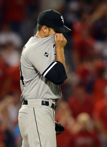 Jun 6, 2014; Anaheim, CA, USA; Chicago White Sox starting pitcher Andre Rienzo (64) reacts to allowing a run to score in the fifth inning of the game against the Los Angeles Angels at Angel Stadium of Anaheim. Mandatory Credit: Jayne Kamin-Oncea-USA TODAY Sports