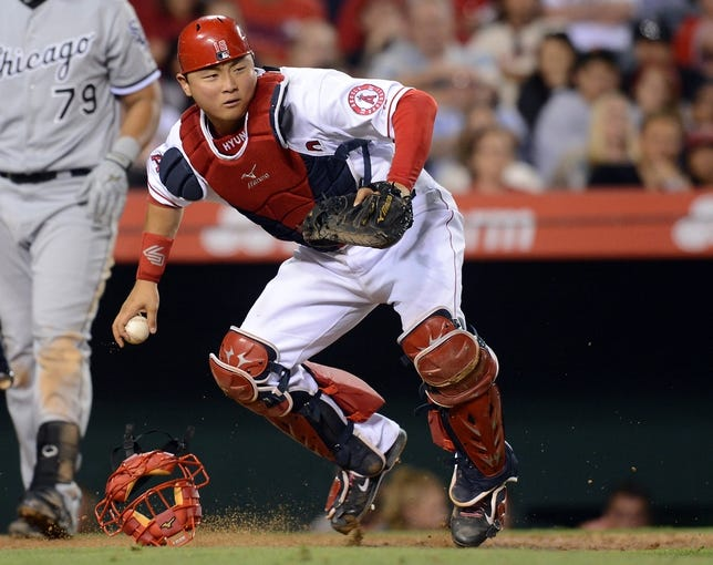 Jun 6, 2014; Anaheim, CA, USA; Los Angeles Angels catcher Hank Conger (16) makes a play in the seventh inning of the game against the Chicago White Sox at Angel Stadium of Anaheim. Angels won 8-4. Mandatory Credit: Jayne Kamin-Oncea-USA TODAY Sports