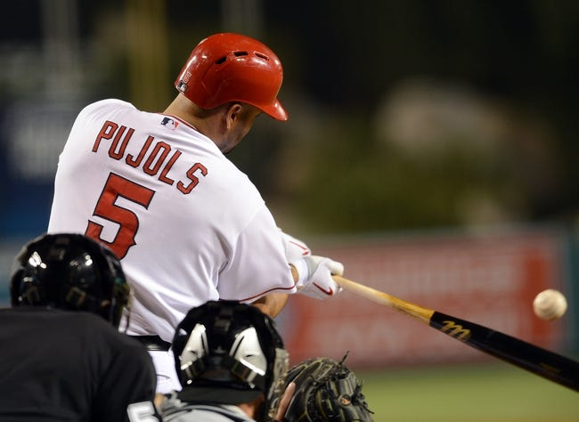 Jun 6, 2014; Anaheim, CA, USA; Los Angeles Angels first baseman Albert Pujols (5) hits a solo home run in the eighth inning of the game against the Chicago White Sox at Angel Stadium of Anaheim. Angels won 8-4. Mandatory Credit: Jayne Kamin-Oncea-USA TODAY Sports