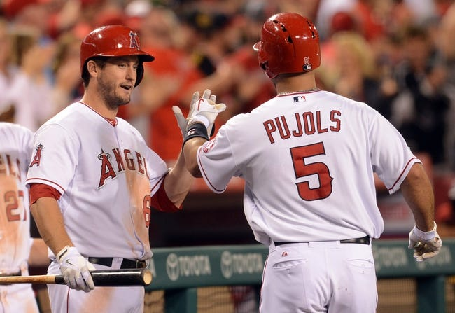 Jun 6, 2014; Anaheim, CA, USA; Los Angeles Angels first baseman Albert Pujols (5) is greeted by third baseman David Freese (6) after a solo home run in the eighth inning of the game against the Chicago White Sox at Angel Stadium of Anaheim. Angels won 8-4. Mandatory Credit: Jayne Kamin-Oncea-USA TODAY Sports