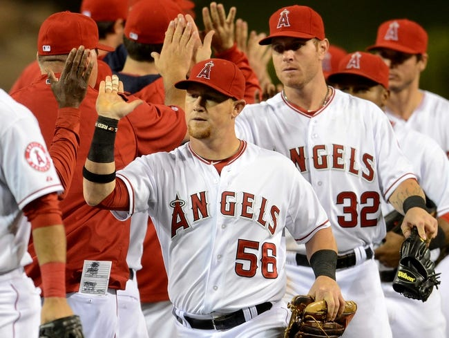 Jun 6, 2014; Anaheim, CA, USA; Los Angeles Angels right fielder Kole Calhoun (56) gets a high five after the game against the Chicago White Sox at Angel Stadium of Anaheim. Angels won 8-4. Mandatory Credit: Jayne Kamin-Oncea-USA TODAY Sports
