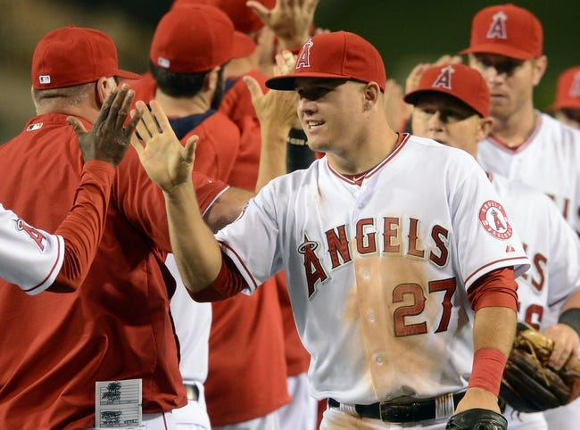 Jun 6, 2014; Anaheim, CA, USA; Los Angeles Angels center fielder Mike Trout (27) gets a high five after the game against the Chicago White Sox at Angel Stadium of Anaheim. Angels won 8-4. Mandatory Credit: Jayne Kamin-Oncea-USA TODAY Sports