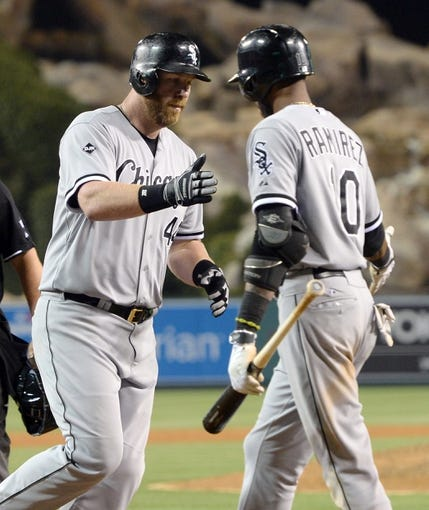 Jun 6, 2014; Anaheim, CA, USA; Chicago White Sox designated hitter Adam Dunn (44) is greeted by shortstop Alexei Ramirez (10) after hitting his 450th home run in the ninth inning of the game against the Los Angeles Angels at Angel Stadium of Anaheim. Angels won 8-4. Mandatory Credit: Jayne Kamin-Oncea-USA TODAY Sports