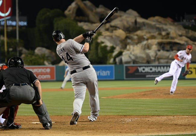 Jun 6, 2014; Anaheim, CA, USA; Chicago White Sox designated hitter Adam Dunn (44) hits his 450th home run off of Los Angeles Angels relief pitcher Ernesto Frieri (49) in the ninth inning of the game at Angel Stadium of Anaheim. Angels won 8-4. Mandatory Credit: Jayne Kamin-Oncea-USA TODAY Sports