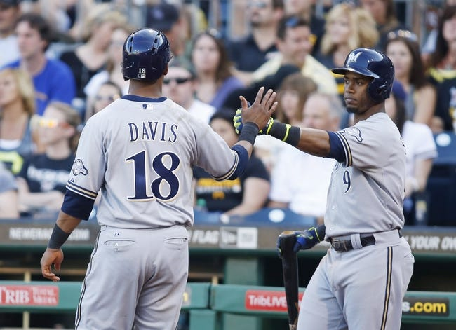 Jun 7, 2014; Pittsburgh, PA, USA; Milwaukee Brewers left fielder Khris Davis (18) is greeted at home plate by shortstop Jean Segura (9) after Davis scored a run against the Pittsburgh Pirates during the eighth inning at PNC Park. The Brewers won 9-3. Mandatory Credit: Charles LeClaire-USA TODAY Sports