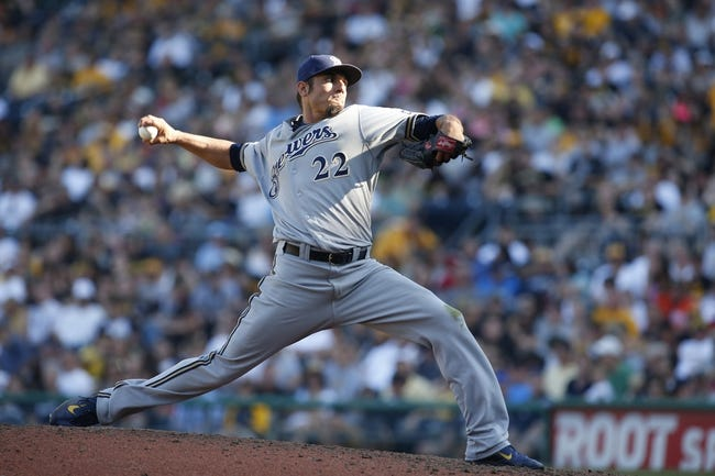 Jun 7, 2014; Pittsburgh, PA, USA; Milwaukee Brewers starting pitcher Matt Garza (22) pitches against the Pittsburgh Pirates during the sixth inning at PNC Park. The Brewers won 9-3. Mandatory Credit: Charles LeClaire-USA TODAY Sports