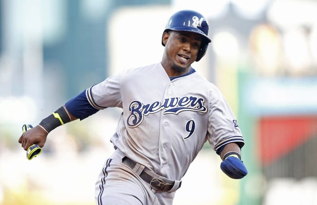 Jun 7, 2014; Pittsburgh, PA, USA; Milwaukee Brewers shortstop Jean Segura (9) runs the bases on his way to scoring against the Pittsburgh Pirates during the eighth inning at PNC Park. The Brewers won 9-3. Mandatory Credit: Charles LeClaire-USA TODAY Sports