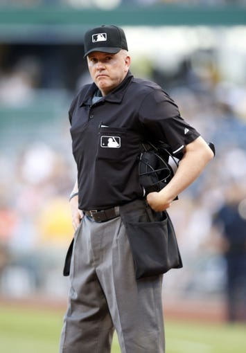 Jun 7, 2014; Pittsburgh, PA, USA; Home plate umpire Mike Everitt (57) looks on between innings of the game between the Pittsburgh Pirates and the Milwaukee Brewers during the ninth inning at PNC Park. The Brewers won 9-3. Mandatory Credit: Charles LeClaire-USA TODAY Sports