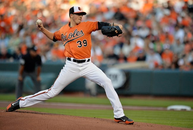 Jun 7, 2014; Baltimore, MD, USA; Baltimore Orioles starting pitcher Kevin Gausman (39) throws in the first inning against the Oakland Athletics at Oriole Park at Camden Yards. Mandatory Credit: Joy R. Absalon-USA TODAY Sports