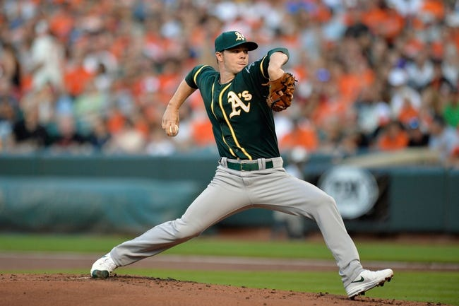 Jun 7, 2014; Baltimore, MD, USA; Oakland Athletics starting pitcher Sonny Gray (54) throws in the first inning against the Baltimore Orioles at Oriole Park at Camden Yards. Mandatory Credit: Joy R. Absalon-USA TODAY Sports