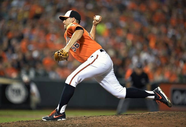 Jun 7, 2014; Baltimore, MD, USA; Baltimore Orioles pitcher Darren O'Day (56) throws in the eighth inning against the Oakland Athletics at Oriole Park at Camden Yards. The Orioles defeated the Athletics 6-3. Mandatory Credit: Joy R. Absalon-USA TODAY Sports