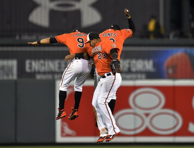 Jun 7, 2014; Baltimore, MD, USA; Baltimore Orioles outfielders David Lough (left) Nelson Cruz (center) and Adam Jones (right) celebrate after a game against the Oakland Athletics at Oriole Park at Camden Yards. The Orioles defeated the Athletics 6-3. Mandatory Credit: Joy R. Absalon-USA TODAY Sports
