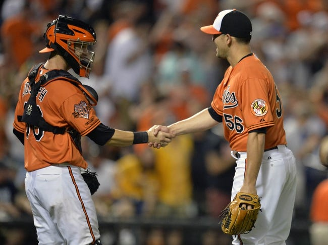 Jun 7, 2014; Baltimore, MD, USA; Baltimore Orioles pitcher Darren O'Day (56) is congratulated by catcher Caleb Joseph after a game against the Oakland Athletics at Oriole Park at Camden Yards. The Orioles defeated the Athletics 6-3. Mandatory Credit: Joy R. Absalon-USA TODAY Sports