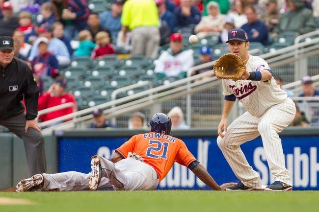 Jun 7, 2014; Minneapolis, MN, USA; Houston Astros center fielder Dexter Fowler (21) dives back to first base against the Minnesota Twins first baseman Joe Mauer (7) at Target Field. Mandatory Credit: Brad Rempel-USA TODAY Sports