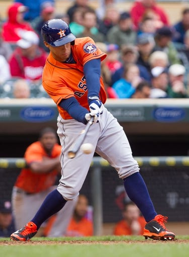 Jun 7, 2014; Minneapolis, MN, USA; Houston Astros right fielder George Springer (4) at bat against the Minnesota Twins at Target Field. Mandatory Credit: Brad Rempel-USA TODAY Sports