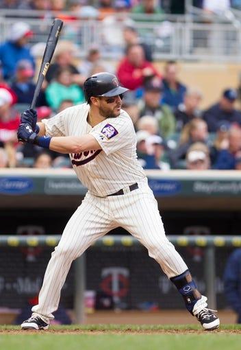 Jun 7, 2014; Minneapolis, MN, USA; Minnesota Twins third baseman Trevor Plouffe (24) at bat against the Houston Astros at Target Field. Mandatory Credit: Brad Rempel-USA TODAY Sports