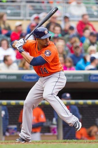Jun 7, 2014; Minneapolis, MN, USA; Houston Astros designated hitter Jesus Guzman (14) at bat against the Minnesota Twins at Target Field. Mandatory Credit: Brad Rempel-USA TODAY Sports