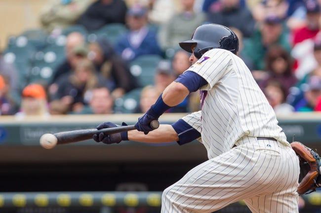 Jun 7, 2014; Minneapolis, MN, USA; Minnesota Twins second baseman Brian Dozier (2) bunts against the Houston Astros at Target Field. Mandatory Credit: Brad Rempel-USA TODAY Sports