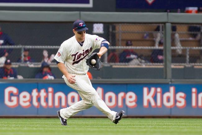 Jun 7, 2014; Minneapolis, MN, USA; Minnesota Twins left fielder Josh Willingham (16) fields a ground ball against the Houston Astros at Target Field. Mandatory Credit: Brad Rempel-USA TODAY Sports