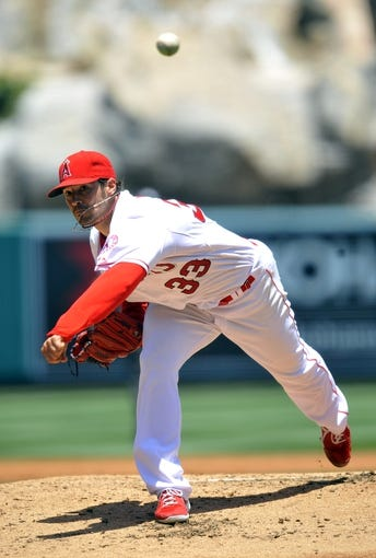 June 8, 2014; Anaheim, CA, USA; Los Angeles Angels starting pitcher C.J. Wilson (33) pitches the second inning against the Chicago White Sox at Angel Stadium of Anaheim. Mandatory Credit: Gary A. Vasquez-USA TODAY Sports