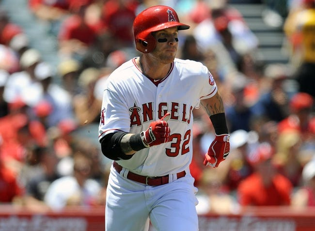 June 8, 2014; Anaheim, CA, USA; Los Angeles Angels left fielder Josh Hamilton (32) runs after hitting an RBI single in the third inning against the Chicago White Sox at Angel Stadium of Anaheim. Mandatory Credit: Gary A. Vasquez-USA TODAY Sports